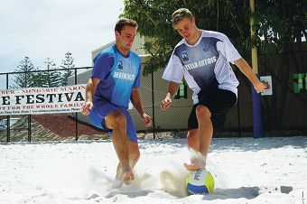 Shane and Aaron Elton practise beach soccer at Mindarie Marina.