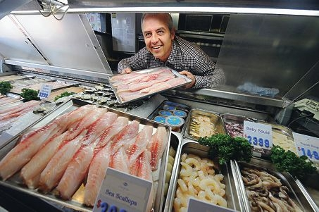 Sweetlips Fish and Chips owner Michael Waldock with fresh WA seafood. Picture: Marcus Whisson d405174