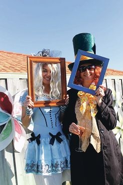 Kim du Bois as Alice and Alison Skillen as the Hatter at the Tea Party they organised last month.