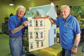 George Bolin and Les Hendon with the dolls' house. Picture: Emma Reeves d408951