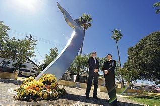 City of Vincent Mayor John Carey and Vietnamese Community Association president Anh Nguyen stand beside the new monument resembling a small boat riding a giant wave. Picture: Marcus Whisson d410218