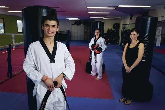Taekwondo exponent Mark Torre shows off his black belt, watched by instructor Karen Doyle and his proud mother Teresa Torre. Picture: Emma Reeves www.communitypix.com.au d409721