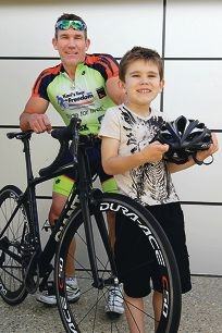 Kevin Williams, with his son Finnbar, prepares for a 1000km ride to raise funds for Teen Challenge. Picture: Martin Kennealey d410118