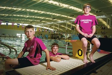 Ross Goodison (12), left, will be helping the Cureageous Pinks James Claxton (16) and Ben Roberts (14) get through their six-hour breaststroke marathon by covering their lunch breaks. |Picture: Emma Reeves www.communitypix.com.au d410219
