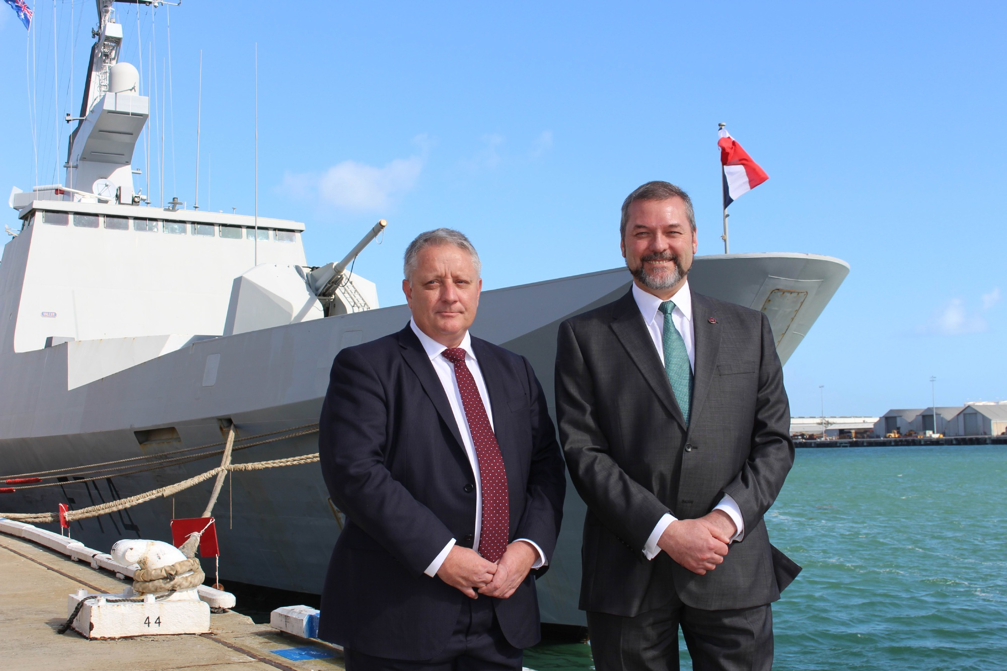 Brent Clark, DCNS's Australian director for strategy and communications, with Commerce Minister Michael Mischin in front of the French Navy frigate Guepratte, which docked in Fremantle to coincide with the event. Picture: Bryce Luff