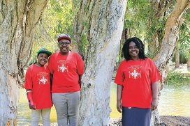 Family of volunteers: Fadzi Mutambiranwa (right) with her sons Mufaro and Munashe. Picture: Cam Campbell