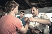 Guntars Baikovs with Australian arm wrestling lightweight champion Jesse Johnson at a seminar in Melbourne.