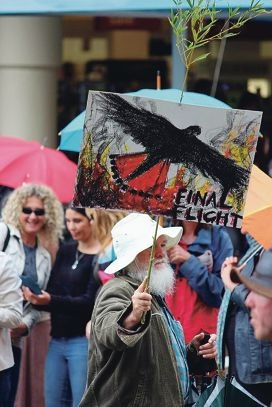 A protester marches at the rally in Perth CBD on Saturday.
