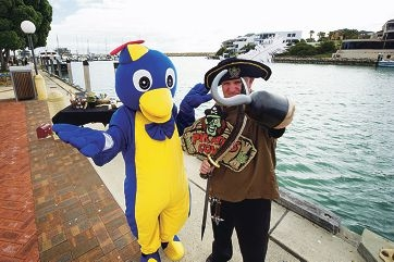 Mindarie Penguin and Darryl Canglesey (Pirate) preparing for the Mindarie Marina Festival with items for the stall 'Living Gifts by Fiona'. Picture: Emma Reeves d409497