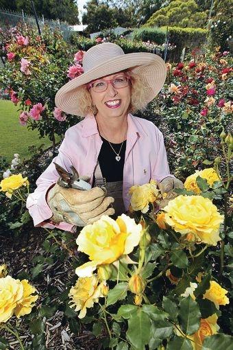 Colour burst: Patsy Durack among her flowers. Picture: Bruce Hunt d409587