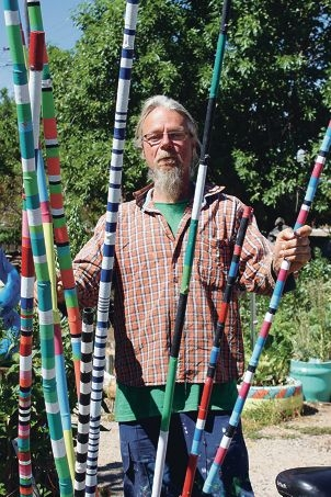 Tom de Munk-Kerkmeer with his creation.