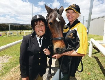 Cameron Fane with his horse Rambo and trainer Deb Harrison.