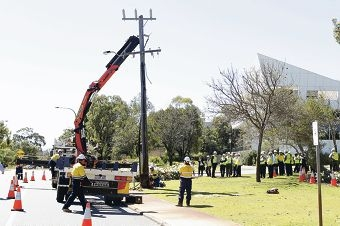 The final power pole is removed.