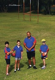 Kwinana Junior Knights coach David Acker with Jordan Selden, Aaron Acker and Samuel Rowse. Picture: Marie Nirme d409427