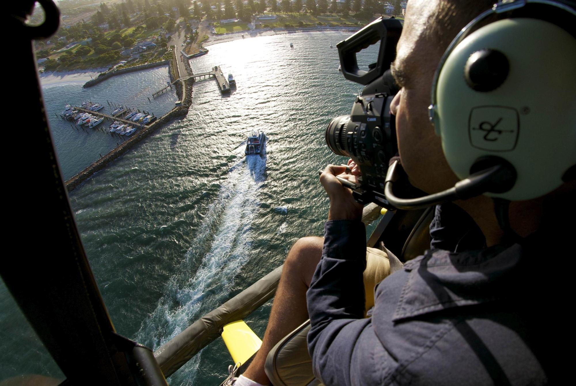 Leighton De Barros filming the expedition vessel arriving back in port in Esperance.