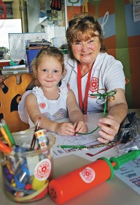 Jean Rodgers of Southern River brings a smile to four-year-old Lilah Rooke's face. Picture: David Baylis d409540