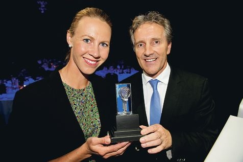 Former Australian tennis player Alicia Molik and Hopman Cup event director Steve Ayles with the new trophy.