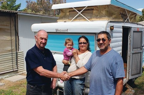 John Stallard delivers the caravan to Tammie with daughter Halana and husband David, who had been living in a tent.
