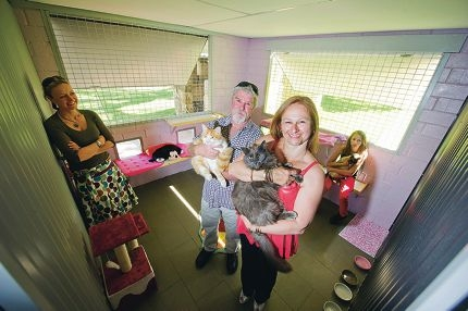 Peedac's Alex Kepes with Mick, Kay and April Hunton and cats Merlin, Munchkin and Mocha. Picture: Emma Reeves www.communitypix.com.au d408732