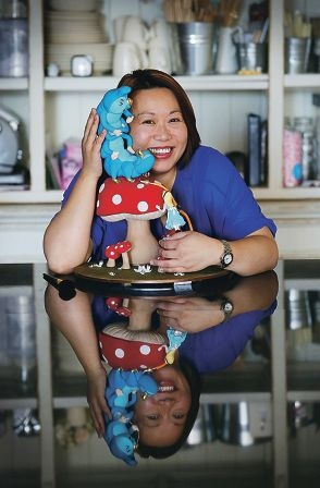 Winnie Lee with her award-winning cake 'Alice's Conversation with a caterpillar'. Picture: Andrew Ritchie d409257