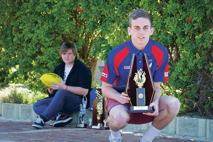 Jack Porter with brother Ethan. Hard-working Jack has a bright future in Australian Rules Football. d408850