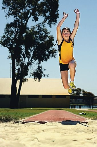 Champion athlete Olivia Ridley completes a triple jump. Picture: Marcus Whisson www.communitypix.com.au d408884