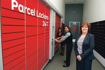 Postal services officers Teresa Leishman and Toni Mason with postal manager Helena Morris and the new 24/7 parcel lockers at Clarkson Post Office. Picture: Emma Reeves d408366