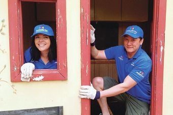 Tina Levien and Jason Ng upgrade a cubby house at the Pat Giles Centre.