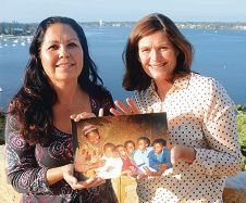Julie Scanlon and Jacqui Gilmour hold a photograph of School of St Yared student Abech (second from right), her brothers and mother. Picture: Jon Bassett