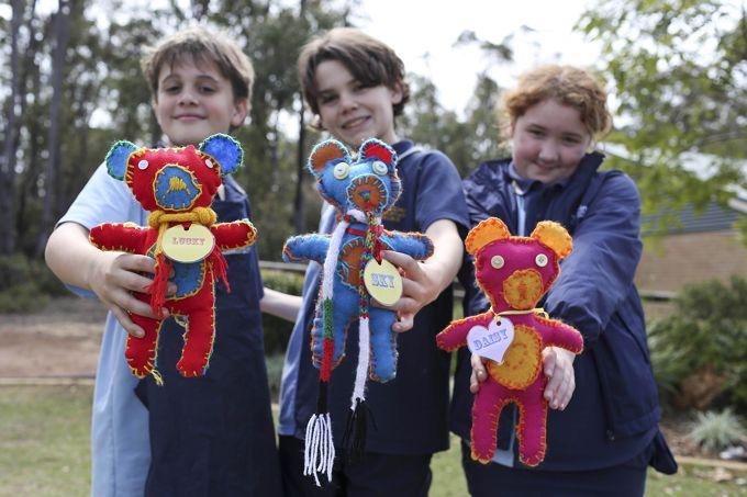 Mundaring Christian College students Ewan Van de Nardort, Findlay Evans and Jacinta Baker with their teddies.