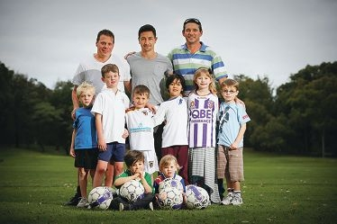 Dads got their backs: L-R Chris Bennett, Jacob Burns and James Smith with their kids who are taking part in a new soccer competition.