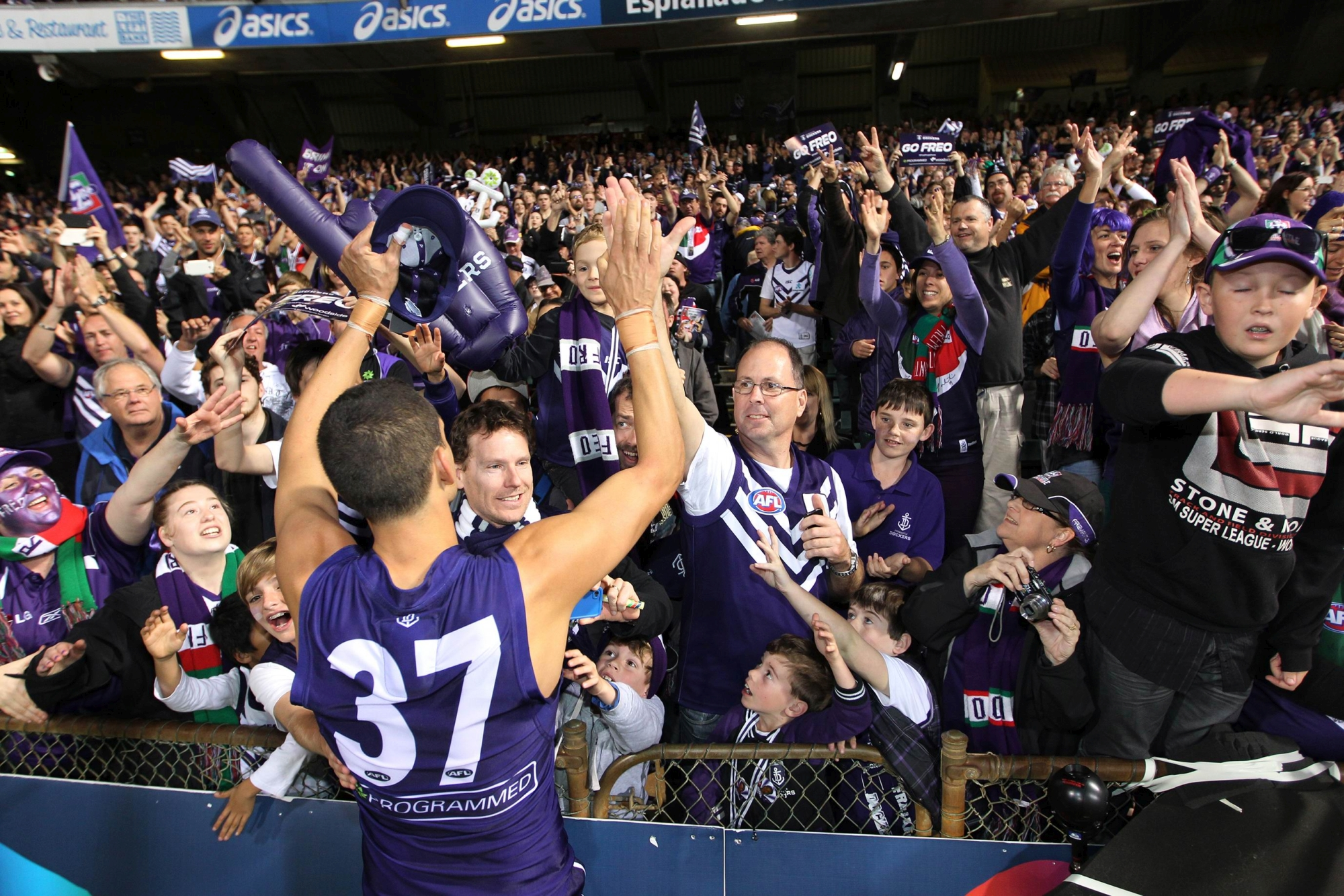 All Australian Michael Johnson acknowledges the crowd after the Dockers' historic win. Picture: Andrew Ritchie