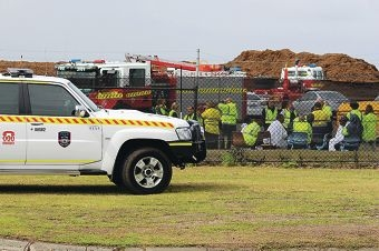 Emergency services and staff from the recycling facility after the evacuation. Picture: Claire Ottaviano