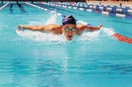 Perth College student Brianna Throssell swimming the butterfly.