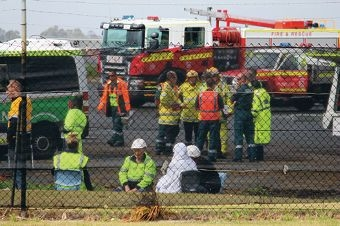 Emergency services and staff from the recycling facility after the evacuation.