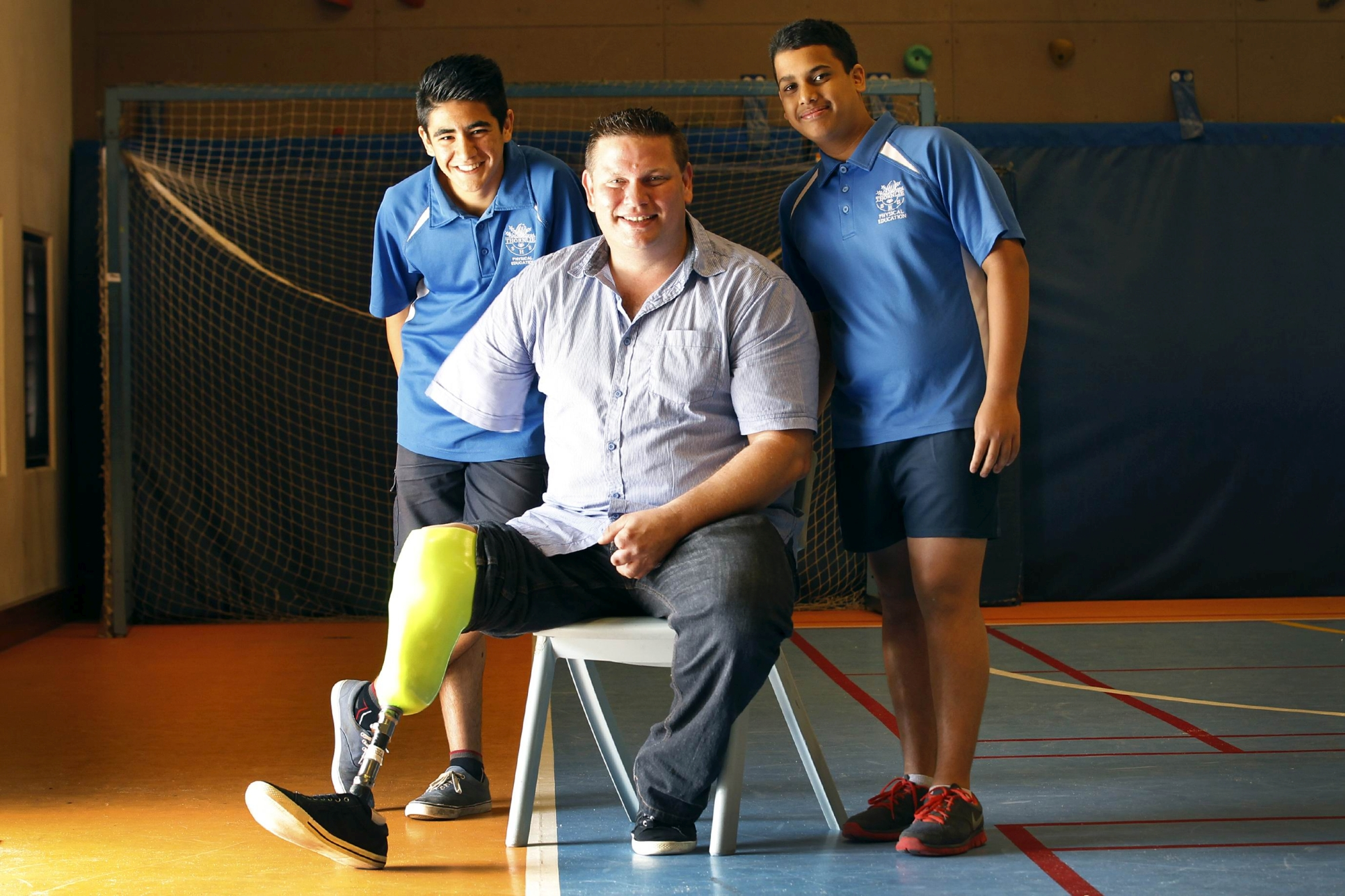 Jonathan Beninca with students Yogesh Bora and Rash Mohammadzadeh. Picture: Marcelo Palacios d407290