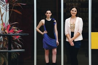 Perth Fashion Festival top student designer Melanie Nicholls with her award-winning garment worn by friend and fellow student Sheridan Savage. Picture: Marcus Whisson d408137