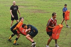 Stirling Mortlock puts Associates juniors through their paces. Picture: Marcus Whisson d407295