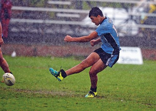 Keelyn Tuata Edwards (Under-18s) strove to play well in the bad weather.