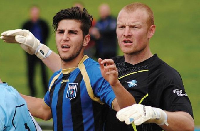 Sorrento keeper Curtis Aspden tussles with Bayswater defender Chris Saldaris. Picture: Peter Simcox