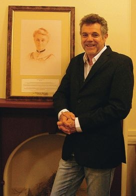 Trevor Todd and a portrait of Edith Cowan.