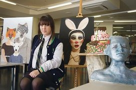 Year 12 student Taylah Diskin with her art piece and other students' artwork. Picture: Emma Reeves www.communitypix.com.au d406954