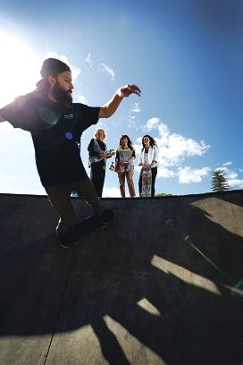 Heather Henderson and Subiaco staff Natasha Annan and Ra Jarden-Osborne watch a skateboarder at the park. Picture: Andrew Ritchie d407173