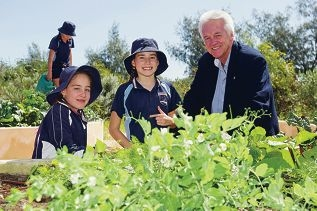 Louise Keogh, Isabella Parsons with Geoff Newby-Butt (Rotary club) in the new community garden at Quinns Beach Primary School.