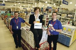 Emily Minchin of Desert Feet with Officeworks staff Geoff Tearle and Derek Carroll.Picture: Emma Reeves d407420