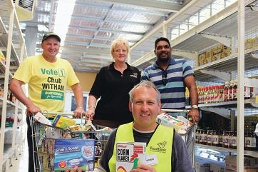 South West Region MLC Colin Holt, Peel Foodbank branch manager Caroline Cox , WA senate candidate David Wirrpanda and (front) Peel Foodbank volunteer Andrew Hives.