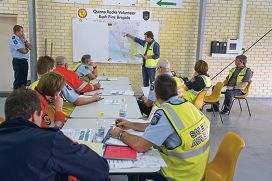 Brian Inglis talking to fire fighters, police and others about bush fire exercises