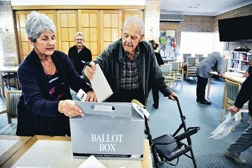 Trinity Village resident Douglas Favas casts his vote with the help of his daughter Helen Walsh.Picture: Marcus Whisson d407182