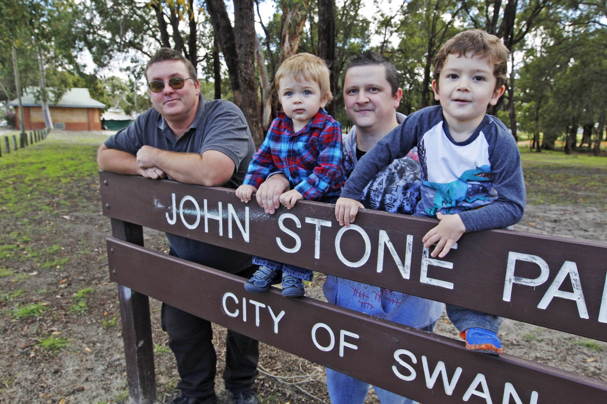 Michael Clement with Troy Condo and sons Ethan and Lincoln at John Stone Park. Picture: Bruce Hunt d406860