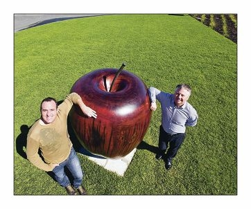 Bryson Wernick, from Landscaping WA, and designer Peter McMeikan with a giant apple carved from jarrah.